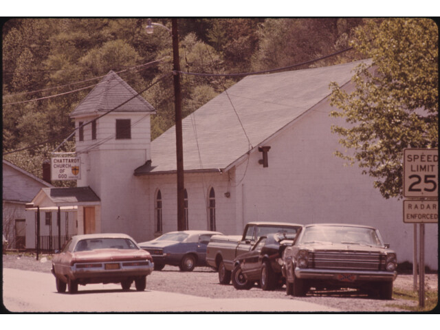 ONE OF THE ENTRANCES TO CHATTAROY  WEST VIRGINIA  NEAR WILLIAMSON  LEADS PAST A CHURCH OF GOD. THERE ARE MANY SMALL... - NARA - 556460 image
