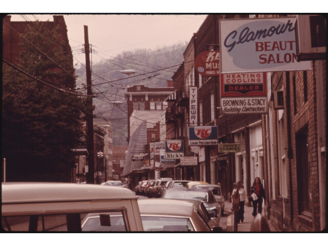 MAIN STREET OF LOGAN  WEST VIRGINIA  SHOWING A NARROW STREET WITH PARKING ON ONLY ONE SIDE WHICH IS TYPICAL IN MANY... - NARA - 556422 image